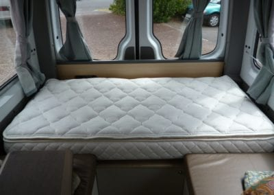 Bed with quilted mattresses